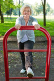 Senior woman exercising on keep fit trail Royalty Free Stock Image