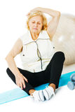 Senior Woman Exercising On Mat Royalty Free Stock Photos