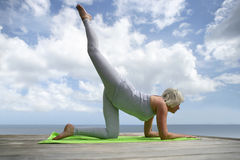Senior woman exercising outside Stock Image