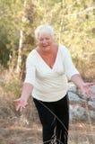 Senior woman exercising outside in park  . Royalty Free Stock Photo
