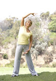 Senior Woman Exercising In Park Stock Photos