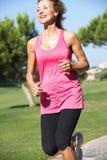 Senior Woman Exercising In Park Royalty Free Stock Photos