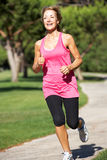 Senior Woman Exercising In Park Royalty Free Stock Photo