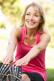 Senior Woman Exercising In Park Royalty Free Stock Images