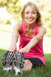 Senior Woman Exercising In Park Stock Image