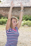 Senior woman exercising in park doing her stretches outdoor. Royalty Free Stock Images