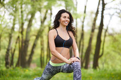 Senior woman exercising in park while listening to music. Royalty Free Stock Photo