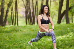 Senior woman exercising in park while listening to music. Royalty Free Stock Photography