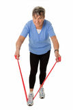 Senior woman exercising with rubber band Royalty Free Stock Image