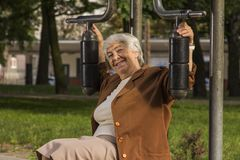 Senior woman exercising In sport Park. Happy senior woman exercising In sport Park Royalty Free Stock Image