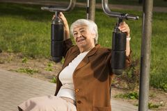 Senior woman exercising In sport Park Royalty Free Stock Photography