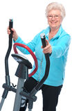 Senior woman exercising on stepper Stock Photography