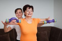 Senior woman exercising with trainer Royalty Free Stock Photo
