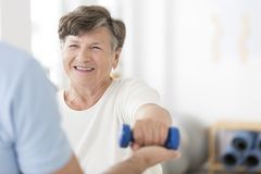 Senior woman exercising with weights royalty free stock images