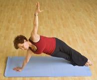 Senior woman exercising yoga. Senior woman doing yoga in a gym Royalty Free Stock Photos