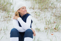 Senior woman with eyes closed at beach Royalty Free Stock Photography