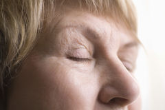 Senior Woman With Eyes Closed Royalty Free Stock Photography
