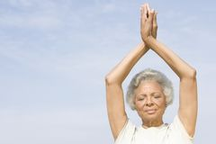 Senior Woman With Eyes Closed In Yoga Pose Royalty Free Stock Images