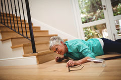 Senior woman fallen down from stairs. At home stock photos