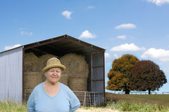 Senior woman on farmland Stock Photo