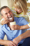 Senior Woman Feeding Husband Ice Cream Royalty Free Stock Image