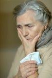 Senior woman feel unwell. Portrait of a senior woman feel unwell Royalty Free Stock Images