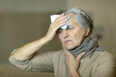 Senior woman feel unwell. Portrait of a senior woman feel unwell stock photography