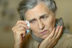 Senior woman feel unwell. Portrait of a senior woman feel unwell Stock Images