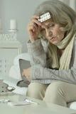 Senior woman feel unwell. Portrait of senior woman feel unwell at home Stock Image