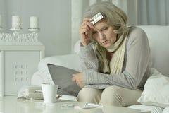 Senior woman feel unwell. Portrait of senior woman feel unwell at home Stock Photos