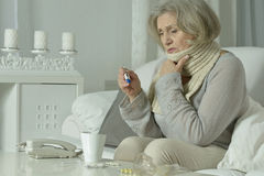 Senior woman feel unwell. Portrait of senior woman feel unwell at home Royalty Free Stock Photo