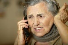 Senior woman feel unwell. Portrait of senior woman with phone feel unwell Stock Photography