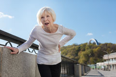 Senior woman feeling backache on the open air Royalty Free Stock Photography