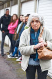 Senior Woman Feeling Intimidated By Group Of Young People. Senior Woman Feels Intimidated By Group Of Young People stock images