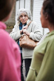 Senior Woman Feeling Intimidated By Teenage Girls. Senior Woman Feels Intimidated By Teenage Girls Stock Photography