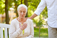 Senior woman feeling sick at summer park. Old age, health problem and people concept - senior woman feeling sick at summer park Royalty Free Stock Photo