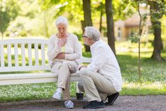 Senior woman feeling sick at summer park. Old age, health problem and people concept - senior women feeling sick at summer park Royalty Free Stock Photo