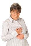 Senior woman feeling unwell Stock Photo