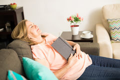 Senior woman fell asleep after reading Royalty Free Stock Image