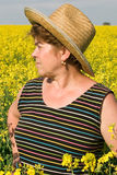 Senior woman in a field of rape Stock Photos