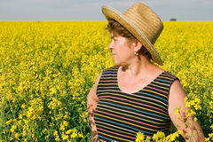 Senior woman in a field of rape Royalty Free Stock Images