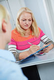 Senior woman filling out medical form Royalty Free Stock Photo