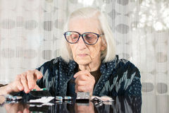 Senior woman finding her today therapy Royalty Free Stock Photography