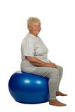 Senior woman with a fit ball Stock Images