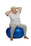 Senior woman with a fit ball Royalty Free Stock Images