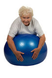 Senior woman with a fitball Royalty Free Stock Images