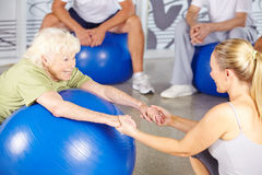 Senior woman with fitness instructor in rehab Stock Photos