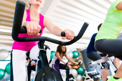 Senior Woman at Fitness Spinning on bike in gym Royalty Free Stock Photography