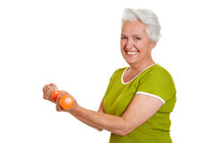 Senior woman at fitness training. Active senior woman at fitness training with dumbbells Stock Photography
