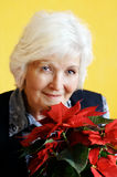 Senior woman and flower royalty free stock photo